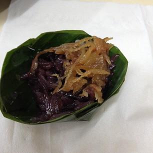 roasted coconut & sticky rice inside a banana leaf