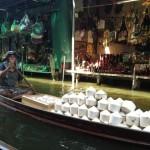 Coconut merchant at a floating market.